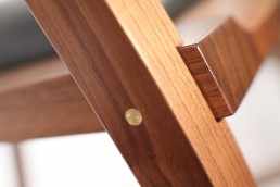close up of brass pin insert in wood