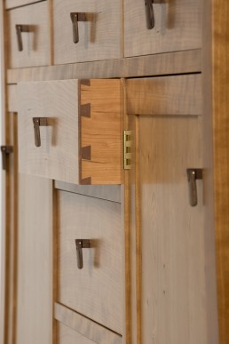 Side view of drawers on the Cherry Buffet with custom walnut drop pulls.