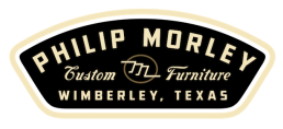 black and brownish logo philip morley furniture