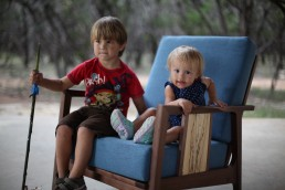 children sitting in chair boy and girl